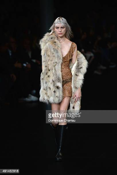 A model walks the runway during the Saint Laurent show as part of the Paris Fashion Week Womenswear Spring/Summer 2016 on October 5 2015 in Paris...