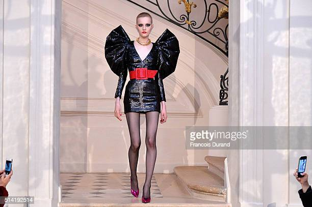 A model walks the runway during the Saint Laurent show as part of the Paris Fashion Week Womenswear Fall/Winter 2016/2017 on March 7 2016 in Paris...