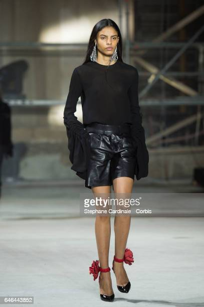 Model walks the runway during the Saint Laurent show as part of the Paris Fashion Week Womenswear Fall/Winter 2017/2018 on February 28, 2017 in...