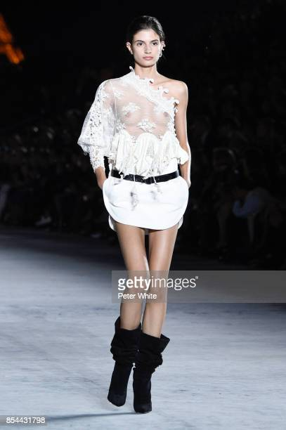 A model walks the runway during the Saint Laurent show as part of the Paris Fashion Week Womenswear Spring/Summer 2018 on September 26 2017 in Paris...