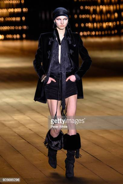 A model walks the runway during the Saint Laurent show as part of the Paris Fashion Week Womenswear Fall/Winter 2018/2019 on February 27 2018 in...