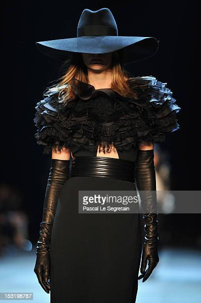 A model walks the runway during the Saint Laurent Spring / Summer 2013 show as part of Paris Fashion Week on October 1 2012 in Paris France