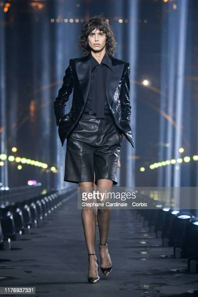 A model walks the runway during the Saint Laurent Womenswear Spring/Summer 2020 show as part of Paris Fashion Week on September 24 2019 in Paris...