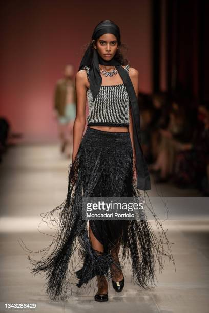 Model walks the runway during the Salvatore Ferragamo fashion show on the fourth day of Milan Fashion Week Women's collection Spring Summer 2022 on...
