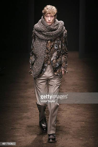 A model walks the runway during the Salvatore Ferragamo show as a part of Milan Menswear Fashion Week Fall Winter 2015/2016 on January 18 2015 in...