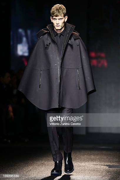 A model walks the runway during the Salvatore Ferragamo show as part of Milan Fashion Week Menswear Autumn/Winter 2013 on January 13 2013 in Milan...