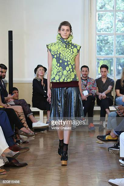 A model walks the runway during the Sandra Weil show at MercedesBenz Fashion Week Mexico Autumn/Winter 2016 at Casa del Lago on April 12 2016 in...