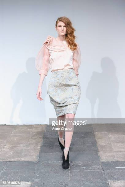 A model walks the runway during the Sandra Weil show at MercedesBenz Fashion Week Mexico Autumn/Winter 2017 at Ex Convento De San Hipolito on April...