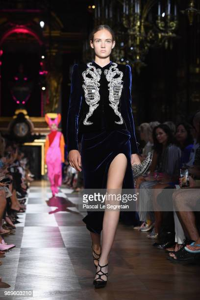 A model walks the runway during the Schiaparelli Haute Couture Fall Winter 2018/2019 show as part of Paris Fashion Week on July 2 2018 in Paris France