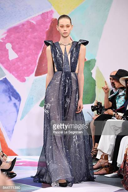 A model walks the runway during the Schiaparelli Haute Couture Fall/Winter 20162017 show as part of Paris Fashion Week on July 4 2016 in Paris France