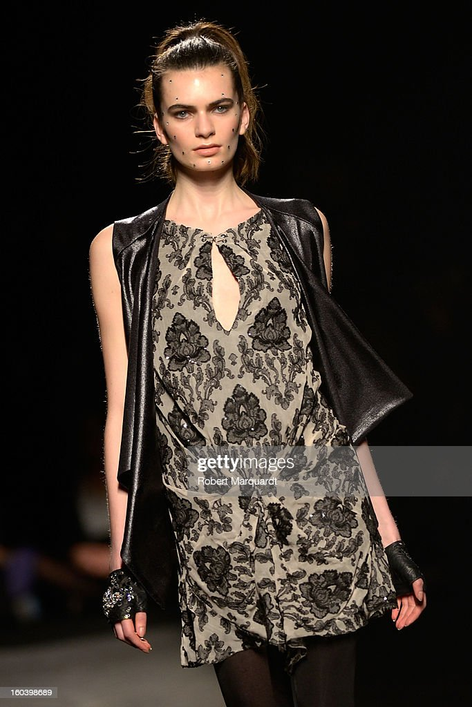 A model walks the runway during the Schipper Arques fashion show as part of the 080 Barcelona Fashion Week Autumn/Winter 2013-2014 on January 30, 2013 in Barcelona, Spain.