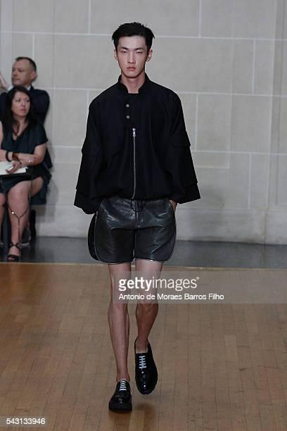 Model walks the runway during the Sean Suen Menswear Spring/Summer 2017 show as part of Paris Fashion Week on June 26, 2016 in Paris, France.