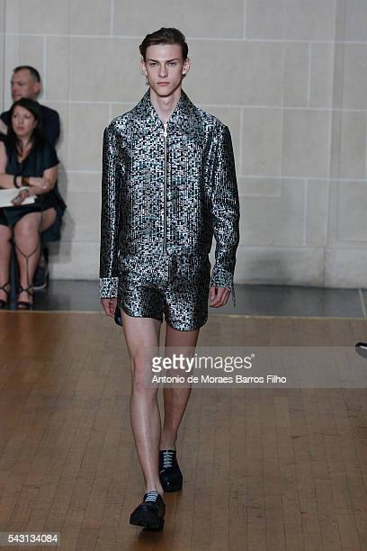 A model walks the runway during the Sean Suen Menswear Spring/Summer 2017 show as part of Paris Fashion Week on June 26 2016 in Paris France