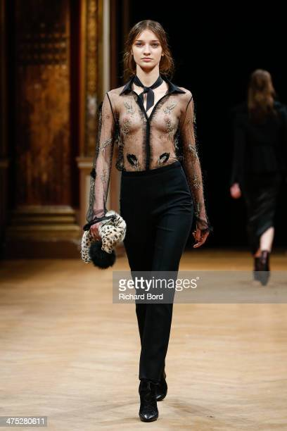 A model walks the runway during the Sharon Wauchob show as part of the Paris Fashion Week Womenswear Fall/Winter 20142015 at Hotel Westin on February...
