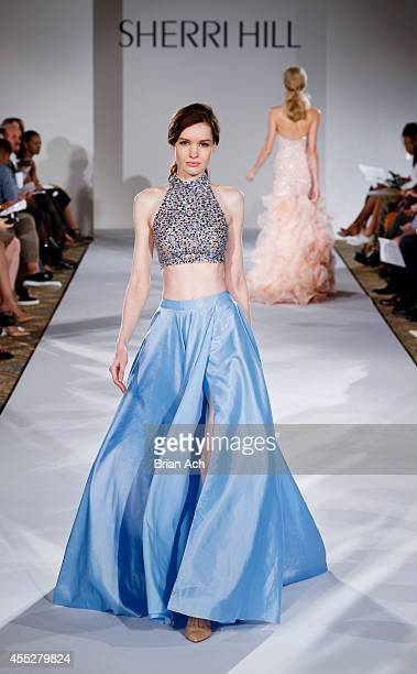 A model walks the runway during the Sherri Hill runway show during MercedesBenz Fashion Week Spring 2015 on September 11 2014 in New York City