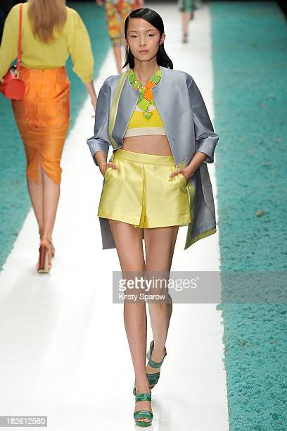 A model walks the runway during the Shiatzy Chen show as part of Paris Fashion Week Womenswear Spring/Summer 2014 on October 1 2013 in Paris France
