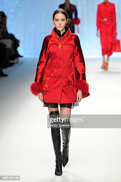 A model walks the runway during the Shiatzy Chen show as part of Paris Fashion Week Womenswear Fall/Winter 2015/2016 at Le Grand Palais on March 10...