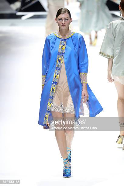 A model walks the runway during the Shiatzy Chen show as part of the Paris Fashion Week Womenswear Spring/Summer 2017 on October 4 2016 in Paris...