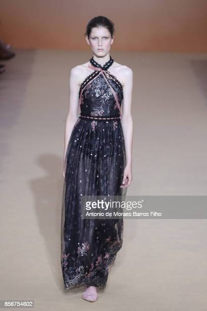 A model walks the runway during the Shiatzy Chen show as part of the Paris Fashion Week Womenswear Spring/Summer 2018 on October 2 2017 in Paris...