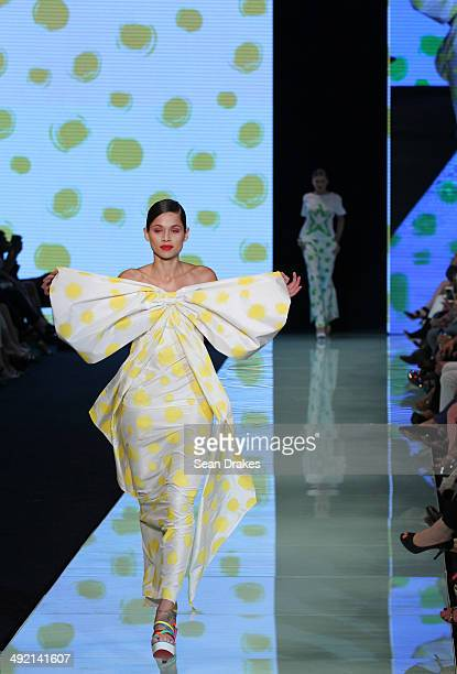 A model walks the runway during the show by Agatha Ruiz de la Prada of Spain at Miami Fashion Week Resort 2014/2015 Day 4 at Miami Beach Convention...