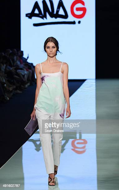 A model walks the runway during the show by Ana Maria Guiulfo of Peru at Miami Fashion Week Resort Summer 2014/2015 Day 2 at Miami Beach Convention...