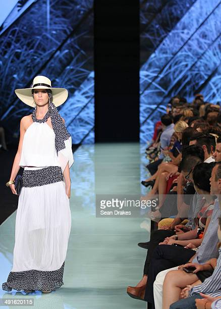 A model walks the runway during the show by Claudia Bertolero of Peru at Miami Fashion Week Resort 2014/2015 Day 2 at Miami Beach Convention Center...