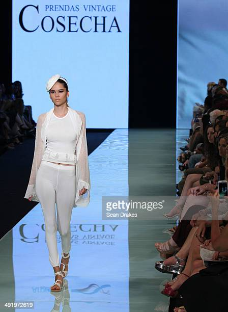 A model walks the runway during the show by Cosecha Prendas Vintage of Argentina at Miami Fashion Week Resort 2014/2015 Day 3 at Miami Beach...