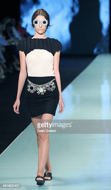 A model walks the runway during the show by Escudo of Peru at Miami Fashion Week Resort Summer 2014/2015 Day 2 at Miami Beach Convention Center on...