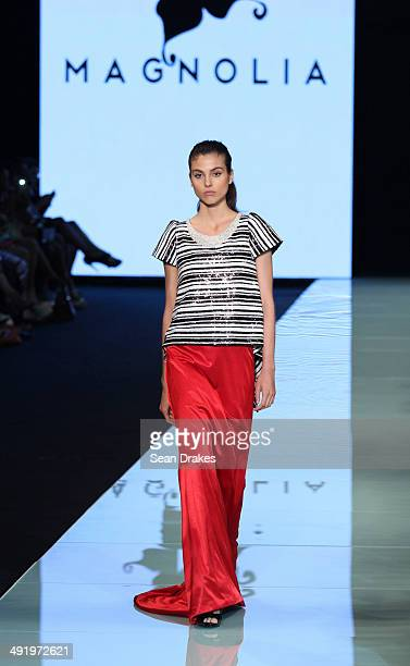 A model walks the runway during the show by Magnolia of Paraguay at Miami Fashion Week Resort 2014/2015 Day 3 at Miami Beach Convention Center on May...
