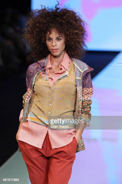 A model walks the runway during the show by Maliparmi of Italy at Miami Fashion Week Resort 2014/2015 Day 3 at Miami Beach Convention Center on May...