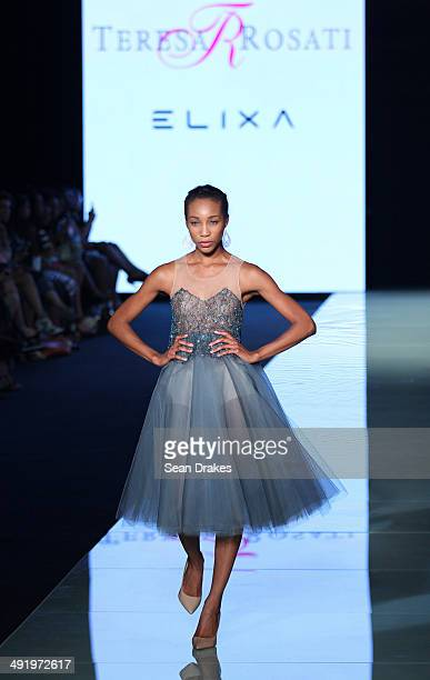 A model walks the runway during the show by Teresa Rosati at Miami Fashion Week Resort 2014/2015 Day 3 at Miami Beach Convention Center on May 17...