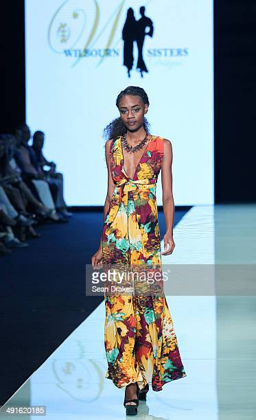 A model walks the runway during the show by The Wilbourn Sisters at Miami Fashion Week Resort Summer 2014/2015 Day 2 at Miami Beach Convention Center...