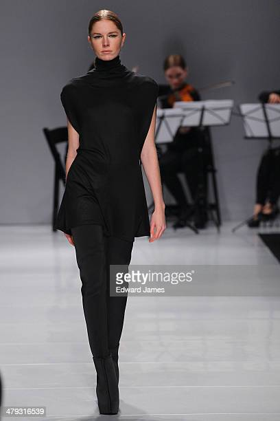 Model walks the runway during the Sid Niegum fashion show during World Mastercard fashion week on March 17, 2014 in Toronto, Canada.
