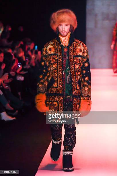 A model walks the runway during the Slava Zaitsev fashion show at Mercedes Benz Fashion Week Russia Fall/Winter 2018/19 at Manege at Manege on March...