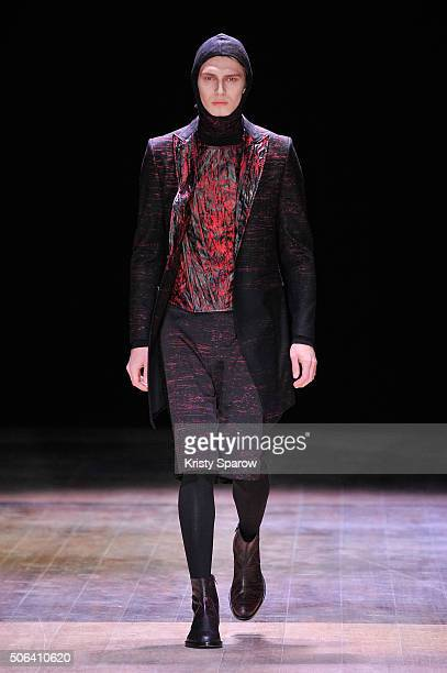 A model walks the runway during the Songzio Menswear Fall/Winter 20162017 show as part of Paris Fashion Week on January 23 2016 in Paris France