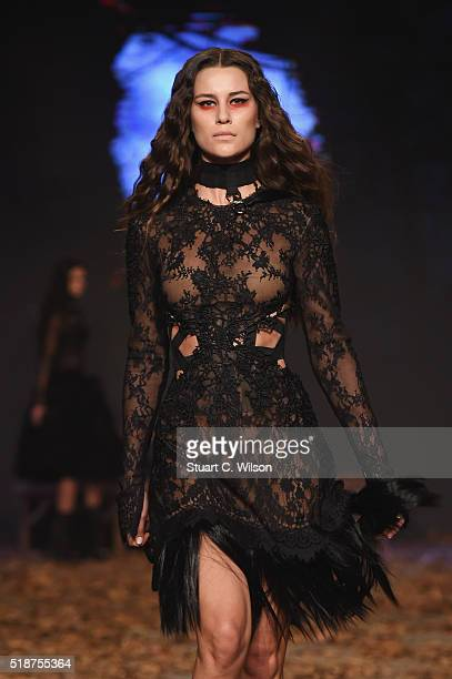 A model walks the runway during the Sotra show at Fashion Forward Fall/Winter 2016 held at the Dubai Design District on April 1 2016 in Dubai United...
