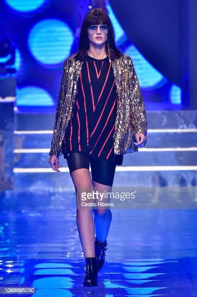 A model walks the runway during the Splash 25 fashion show at Atlantis The Palm on November 16 2018 in Dubai United Arab Emirates