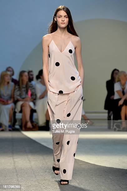 A model walks the runway during the Sportmax show as a part of Milan Fashion Week Womenswear Spring/Summer 2014 on September 20 2013 in Milan Italy