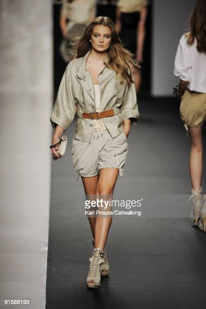 Model walks the runway during the Sportmax Spring Summer 2010 Ready To Wear show as part of the Milan Womenswear Fashion Week Spring/Summer 2010 at...