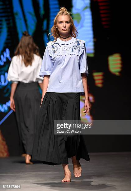 A model walks the runway during the Starch Foundation Salim Azzam show at Fashion Forward Spring/Summer 2017 held at the Dubai Design District on...