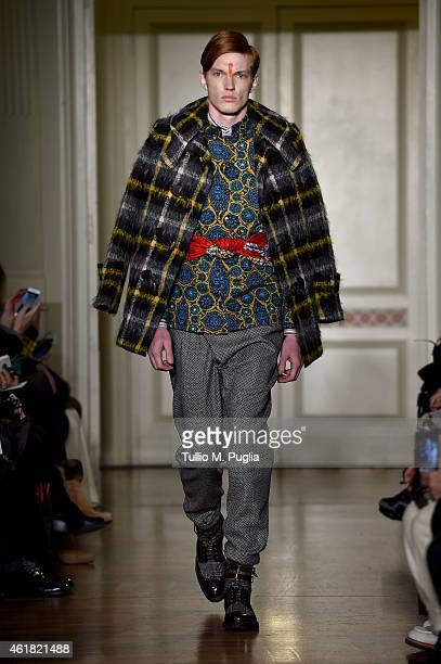 A model walks the runway during the Stella Jean show during the Milan Menswear Fashion Week Fall Winter 2015/2016 on January 20 2015 in Milan Italy