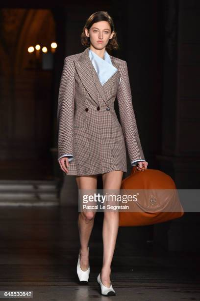 A model walks the runway during the Stella McCartney show as part of the Paris Fashion Week Womenswear Fall/Winter 2017/2018 on March 6 2017 in Paris...
