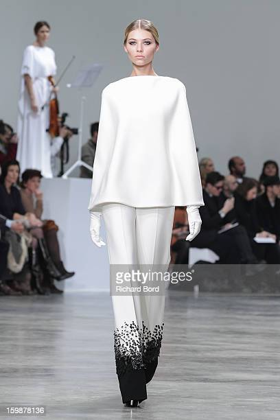 A model walks the runway during the Stephane Rolland Spring/Summer 2013 HauteCouture show as part of Paris Fashion Week at Palais De Tokyo on January...