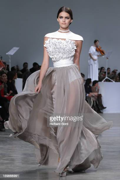 Model walks the runway during the Stephane Rolland Spring/Summer 2013 Haute-Couture show as part of Paris Fashion Week at Palais De Tokyo on January...
