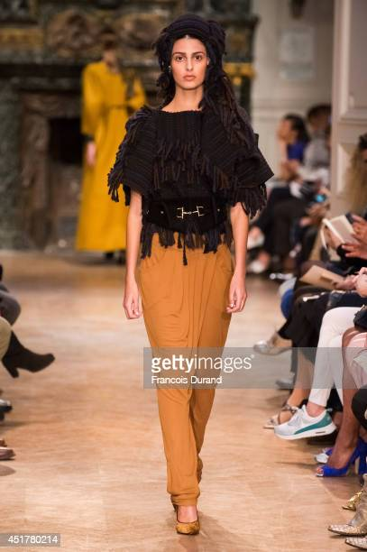 A model walks the runway during the Stephanie Coudert show as part of Paris Fashion Week Haute Couture Fall/Winter 20142015 at on July 6 2014 in...
