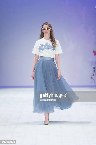Model walks the runway during the Style Collective show at Mercedes-Benz Fashion Week Australia - Weekend Edition at Carriageworks on May 19, 2018 in...