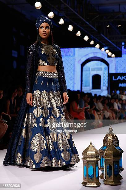 Model walks the runway during the SVA Sonam & Paras Modi show on day 4 of Lakme Fashion Week Summer/Resort 2015 at Palladium Hotel on March 21, 2015...