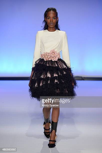 A model walks the runway during the Svetlana Kushnerova show as part of Paris Fashion Week Haute Couture Fall/Winter 2015/2016 at Espace Pierre...
