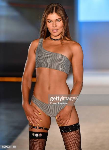A model walks the runway during the SWIMMIAMI KAOHS 2018 Collection fashion show at WET Deck at W South Beach on July 21 2017 in Miami Beach Florida