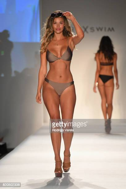 A model walks the runway during the SWIMMIAMI Prey Swim by Audrina Patridge Resort 2018 Collection fashion show at The Tent on July 21 2017 in Miami...